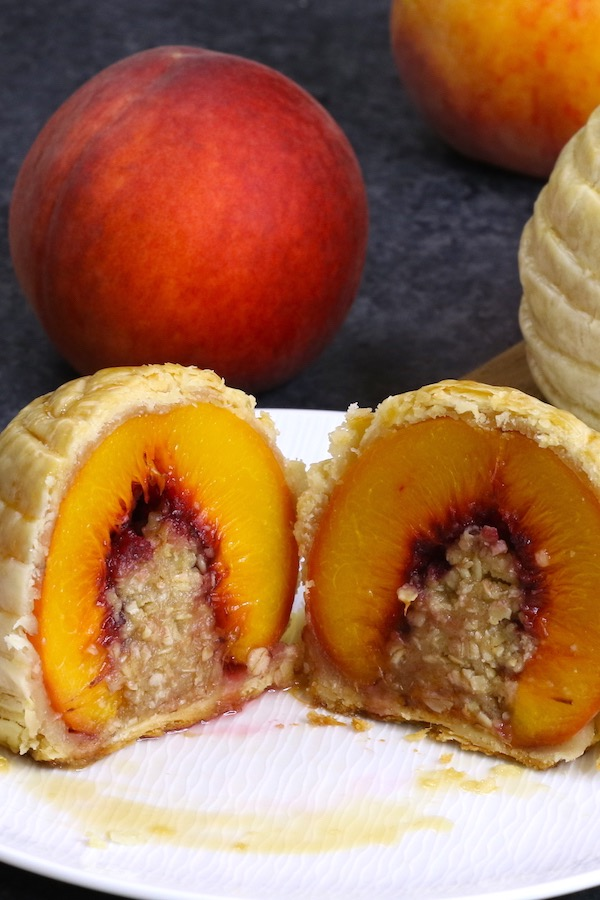 This Stuffed Peach Cobbler is really easy to make, and delivers mouthwatering peach cobbler flavor in each bite! It's one of my favorite summerdessert recipes.